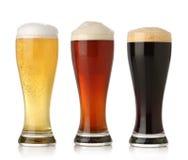 Birra fredda tre, isolata Fotografia Stock