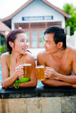 Birra in raggruppamento Immagini Stock