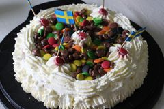 A birtday cake. A birthday cake with candy and swedish flags stock photography