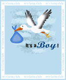 Birth announcement card. Baby boy birth announcement card with a stork carrying a child Stock Photo