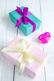 Birth of baby - boxes for gifts on wooden background Stock Photos