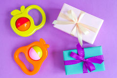 Birth of baby - gift box on purple background Royalty Free Stock Photography