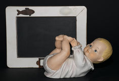 Birth !. A baby near a blackboard where you can write anything Royalty Free Stock Image