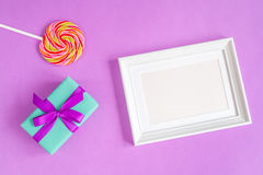 Birth of child - blank picture frame on purple background. Top view Royalty Free Stock Photography