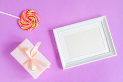 Birth of child - blank picture frame on purple background. Top view Stock Photos