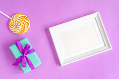 Birth of child - blank picture frame on purple background. Top view Royalty Free Stock Images