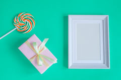 Birth of child - blank picture frame on turquoise background. Top view Royalty Free Stock Images