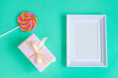 Birth of child - blank picture frame on turquoise background. Top view Royalty Free Stock Photo