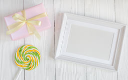 Birth of child - blank picture frame on wooden background. Top view Stock Photos