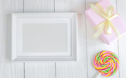 Birth of child - blank picture frame on wooden background. Top view Stock Image