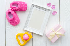 Birth of child - blank picture frame on wooden background. Top view Royalty Free Stock Photo