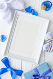 Birth of child - blank picture frame on wooden background. Top view Royalty Free Stock Photos