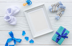 Birth of child - blank picture frame on wooden background. Top view Stock Photography