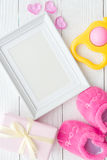 Birth of child - blank picture frame on wooden background. Top view Stock Photo