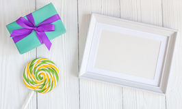 Birth of child - blank picture frame on wooden background. Top view Royalty Free Stock Photography