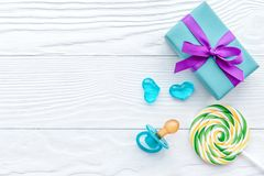 Birth of child - lollipop on wooden background. Top view Stock Photos