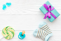 Birth of child - lollipop on wooden background. Top view Royalty Free Stock Images