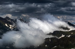 Birth of clouds high in mountains on morning. Stock Photography