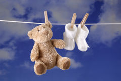 Birth concept teddy bear and baby booties Royalty Free Stock Photography