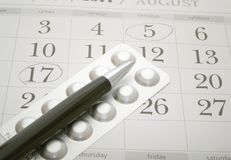Birth control pills and pen Stock Images
