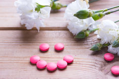 Birth control pills. Birth control pink pills and white flower royalty free stock photography