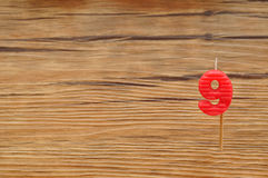 A birth day candle  on a wooden background. Royalty Free Stock Photo
