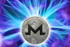 The Birth or fork of monero cryptocurrency. Birth or fork of monero cryptocurrency. Coin background real cold plasma royalty free stock image