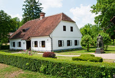 Birth house of Tito, 1st president of Yugoslavia. Birth house and a sculpture of Marshall Josip Broz Tito, first president of Yugoslavia in Kumrovec, today in Stock Image
