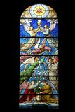 Birth of Jesus. Proclaim the words `Deo et in terra pax par hominibus bonae voluntatis`, stained glass, Church of St. Gervais and St. Protais, Paris Stock Photography
