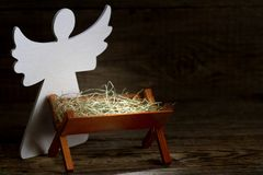 The birth of Jesus Christ abstract christmas nativity scene with manger and angel stock photo