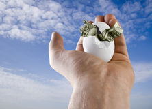 Birth of Money Bird. A hand Holding and egg with an origami Bird inside. Can be a concept for retirement nest egg Stock Image