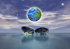 The birth of a new globe over the ocean Royalty Free Stock Image