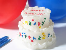 Birthday. Cake, balloons and candles royalty free stock photography