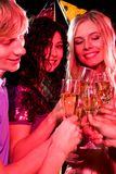 Birthday. Vertical image of three friends clinking glasses with each other during birthday stock images