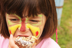 Birthday. Smiling girl with painted face royalty free stock image