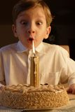 Birthday. Kid posing when blowing out birthday candle Stock Photography