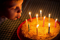Birthday. Boy blow candles on cake Stock Photos