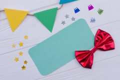 Birthday accessories on white wooden background. royalty free stock photography
