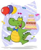 Birthday alligator holding up a birthday cake Stock Photos