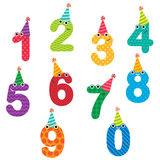 Birthday anniversary numbers with hats. Happy birthday anniversary numbers with faces and hats Stock Photos