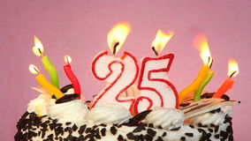 Birthday anniversary 25 years with cake and candles on pink background. Birthday celebration 25 years with cake and candles on pink background. Anniversary stock footage