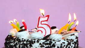 Birthday anniversary 5 years with cake and candles on pink background. Birthday celebration 5 years with cake and different colors candles on pink background stock footage