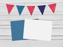 Birthday, baby shower mockup scene with envelope, blank card, party flags. Wooden background. Empty space, top vie Royalty Free Stock Photo