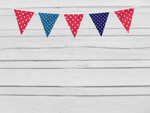 Birthday, baby shower mockup scene. Party flags decoration. Wooden background. Empty space, top view. Royalty Free Stock Photography