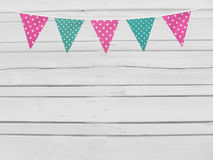 Birthday or baby shower mockup scene. String of pink and mint dotted fabric flags. Party decoration. Old white wooden Royalty Free Stock Image