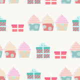 Birthday background with cupcakes and gifts. In a repeat seamless pattern with ornamental presents in boxes with bows and decorative little iced cakes for a Stock Photos