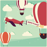 Birthday background hot air balloons and an airplane Stock Images