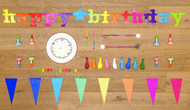 Birthday background items on wooden floor board Royalty Free Stock Images