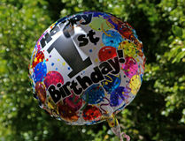 Birthday balloon. This is a first birthday party ballon taken infrom of a tree as background Stock Photography