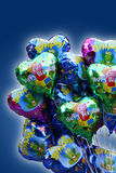 Birthday balloons. Birthday helium balloons on blue background Stock Photography